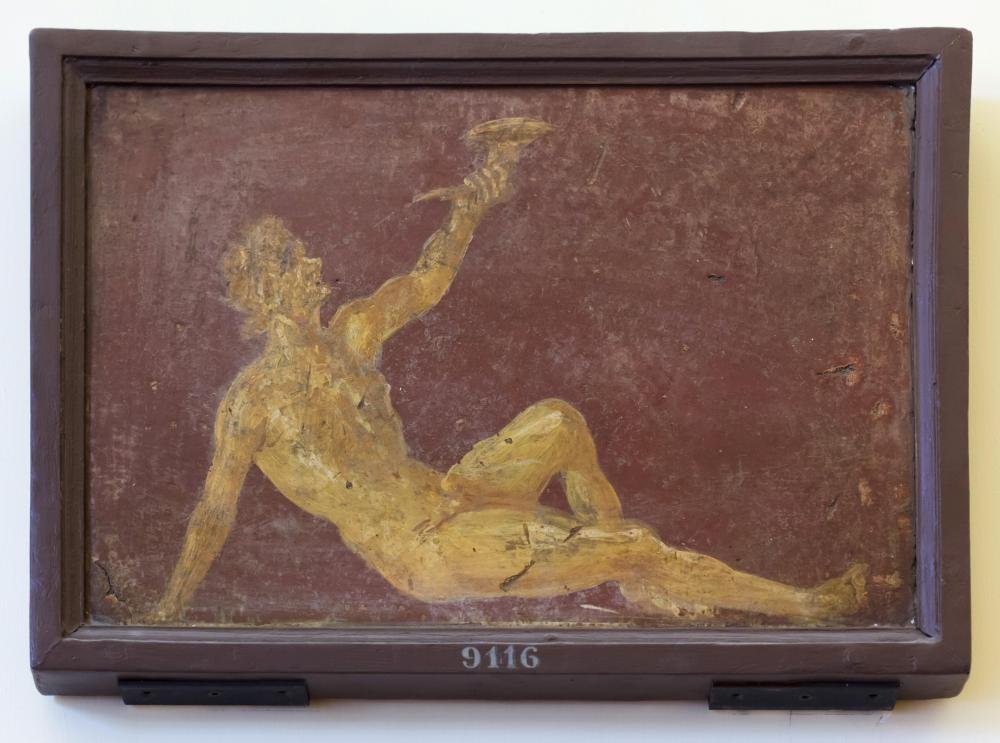 Young faun reclining and lifting a rhyton depicted in the Roman fresco from the Villa Ariadne (Villa Arianna) in Stabiae, now on display in the National Archaeological Museum (Museo Archeologico Nazionale di Napoli) in Naples, Campania, Italy.
